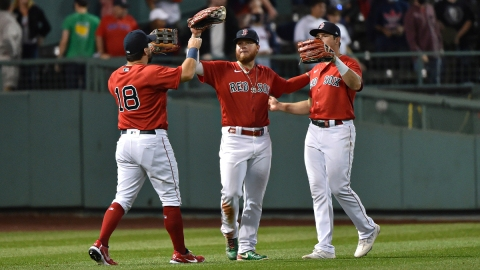 Boston Red Sox outfielders Kyle Schwarber, Alex Verdugo, Hunter Renfroe