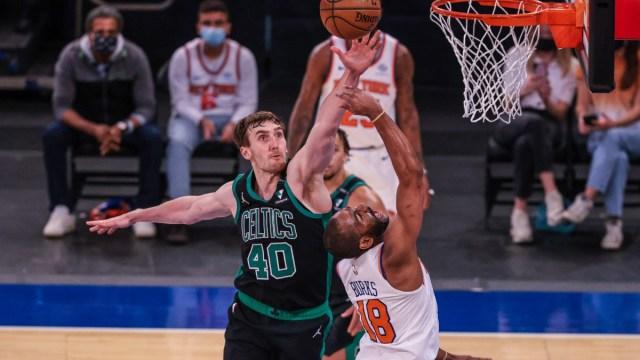 Boston Celtics center Luke Kornet (40) and New York Knicks guard Alec Burks (18)