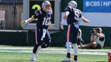 New England Patriots quarterbacks Mac Jones and Brian Hoyer