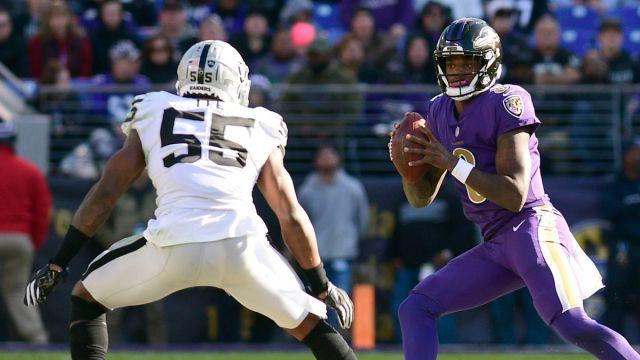 Las Vegas Raiders linebacker Marquel Lee and Baltimore Ravens quarterback Lamar Jackson