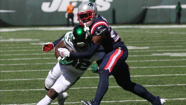 New York Jets running back Michael Carter and New England Patriots cornerback J.C. Jackson