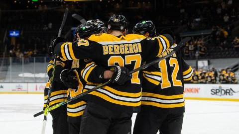 Boston Bruins center Patrice Bergeron (37) and teammates
