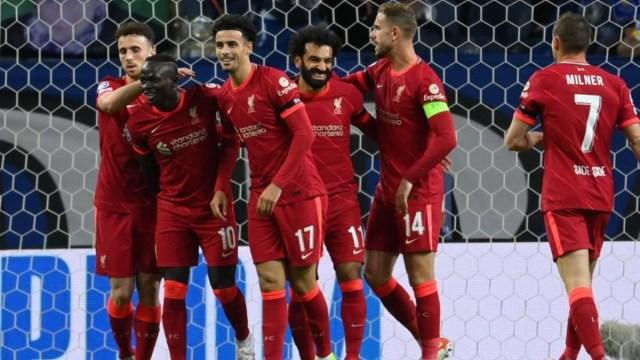 Liverpool players celebrate a goal vs. FC Porto