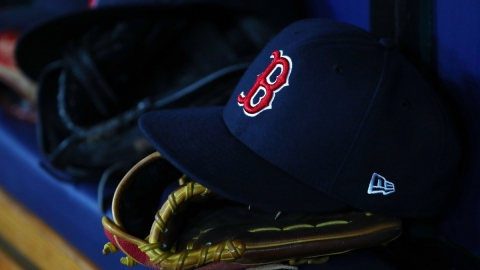 Detail view of Boston Red Sox hat and glove