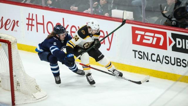 Boston Bruins winger Jake DeBrusk, NHL free agent defenseman Sami Niku
