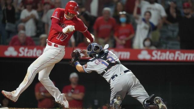 Houston Astros catcher Jason Castro (18) and Los Angeles Angels designated hitter Shohei Ohtani (17)