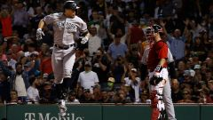 New York Yankees designated hitter Giancarlo Stanton and Boston Red Sox catcher Kevin Plawecki