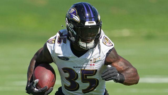 Baltimore Ravens running back Gus Edwards
