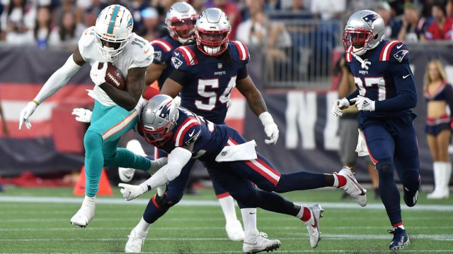New England Patriots and Miami Dolphins players