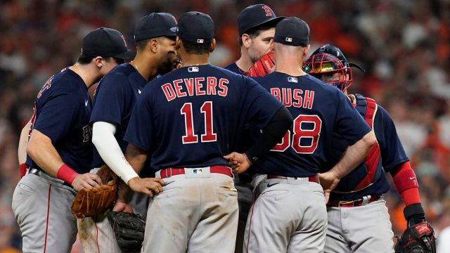 Boston Red Sox players on mound
