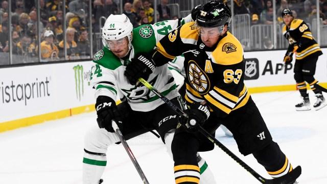 Boston Bruins winger Brad Marchand, Dallas Stars defenseman Joel Hanley