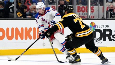 Boston Bruins defenseman Brady Lyle, New York Rangers forward Julien Gauthier