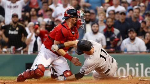 New York Yankees left fielder Brett Gardner (11) and Boston Red Sox catcher Christian Vázquez (7)