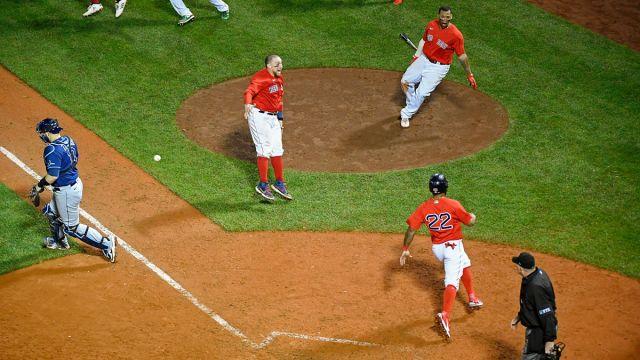 Boston Red Sox catcher Christian Vázquez and outfielder Danny Santana