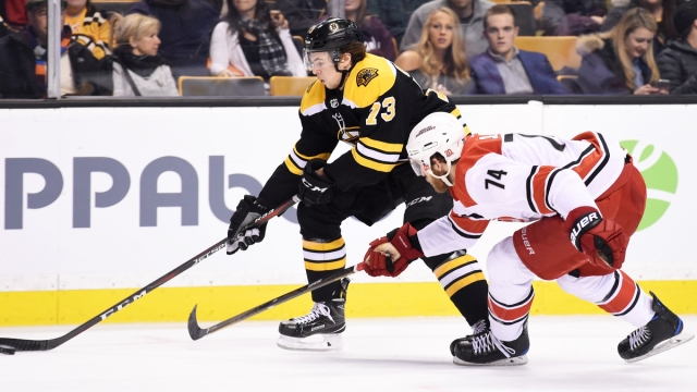 Boston Bruins defenseman Charlie McAvoy, Carolina Hurricanes' Jaccob Slavin