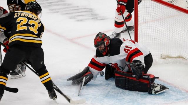 New Jersey Devils goaltender Scott Wedgewood (41) makes a save on Boston Bruins center Jack Studnicka (23)