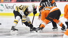 Boston Bruins center Jack Studnicka, Philadelphia Flyers' Sean Couturier