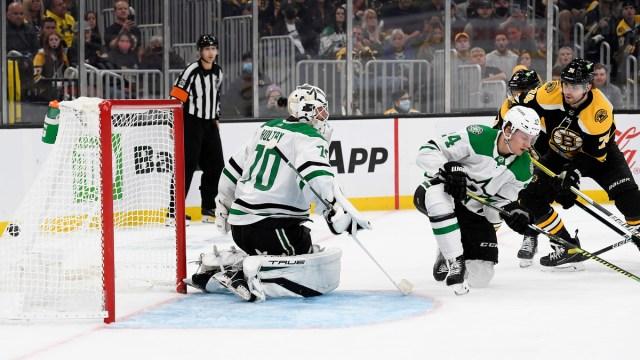 Boston Bruins winger Jake DeBrusk, Dallas Stars goalie Braden Holtby