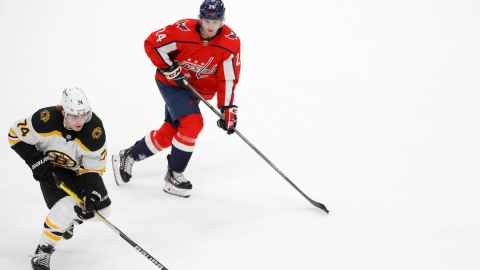 Boston Bruins winger Jake DeBrusk, Washington Capitals forward Connor McMichael