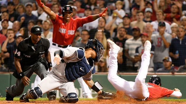 Boston Red Sox outfielder Kiké Hernández (5) and New York Yankees catcher Gary Sanchez