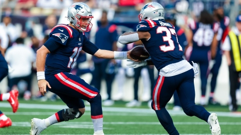 New England Patriots quarterback Mac Jones (10) and running back Damien Harris (37)