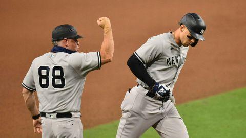 New York Yankees third base coach Phil Nevin, outfielder Aaron Judge