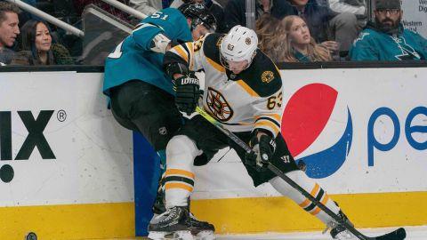 San Jose Sharks defenseman Radim Simek and Boston Bruins left wing Brad Marchand