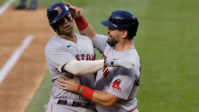 Boston Red Sox third baseman Rafael Devers and designated hitter Kyle Schwarber