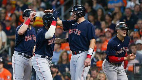 Boston Red Sox third baseman Rafael Devers, catcher Kevin Plawecki, outfielder Enrique Hernandez and infielder Christian Arroyo