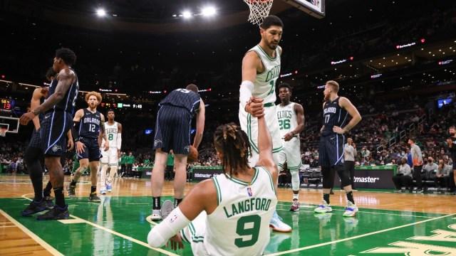 Boston Celtics center Enes Kanter (13) and guard Romeo Langford (9)