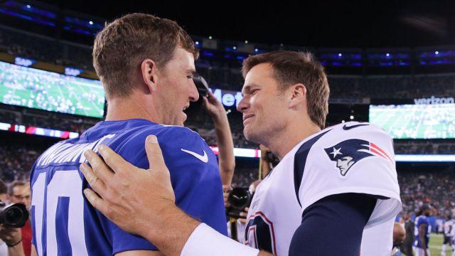 Former New York Giants quarterback Eli Manning and Tom Brady