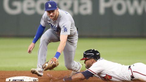 Los Angeles Dodgers second baseman Trea Turner and Atlanta Braves outfielder Eddie Rosario