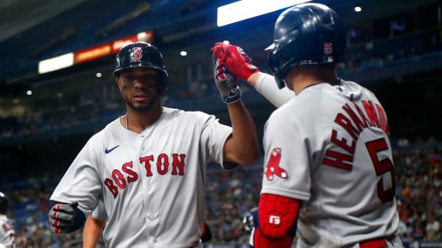 Boston Red Sox shortstop Xander Bogaerts (left) and center fielder Kiké Hernández