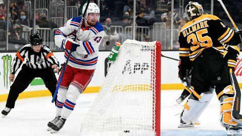 New York Rangers wing Alexis Lafreniere and Boston Bruins goalie Linus Ullmark