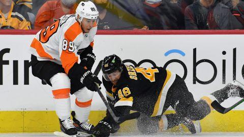 Boston Bruins defenseman Matt Grzelcyk, Philadelphia Flyers' Cam Atkinson