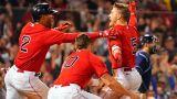 Boston Red sox shortstop Xander Bogaerts and outfielders Hunter Renfroe and Kike Hernandez