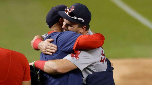 Red Sox left fielder Kyle Schwarber, manager Alex Cora