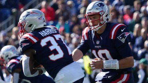 New England Patriots quarterback Mac Jones and running back Damien Harris